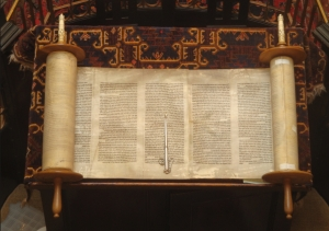 ancient version of the torah on a decorative altar