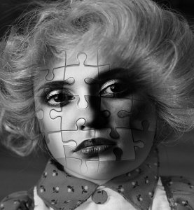 a woman's face divided into a puzzle symbolizing genetic engineering