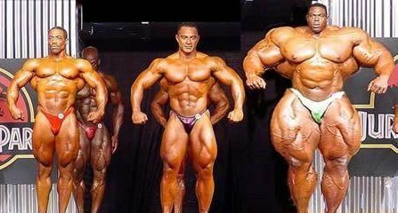 3 bodybuilders on stage each larger than the next